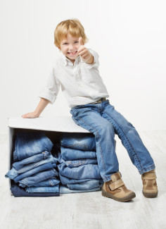 boy with box of jeans canstockphoto11190705